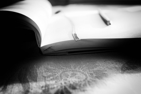 Picture of a blank page in a book to show that someone can't find the time to write