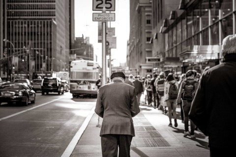 Picture of a man in a business new york street looking at his phone to show the latest Business Internet Technologies