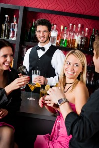 Picture of a few people at the bar at the Christmas party