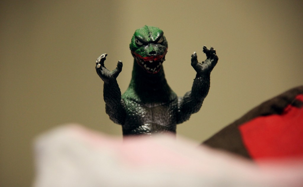 Picture of Godzilla behind some cloth