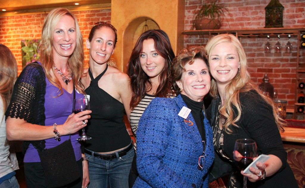 A group of smiling women at a business networking event