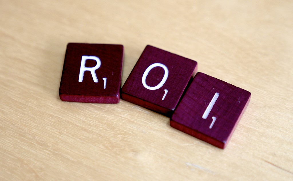 Picture of three scrabble pieces that say 'ROI'