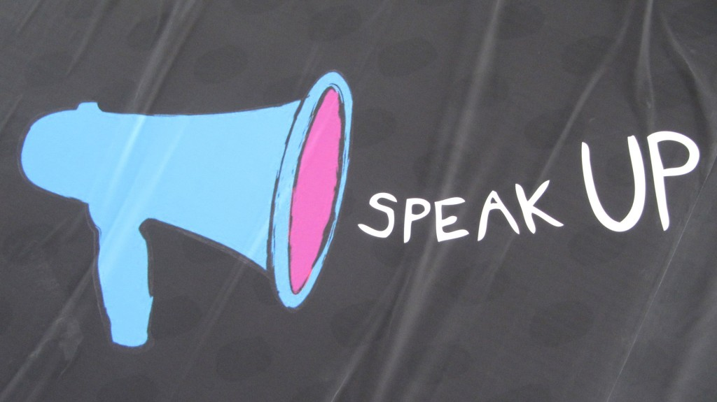 Picture of a megaphone with works Speak Up Next to it