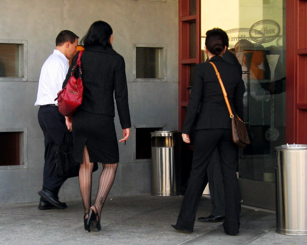 Picture of 3 people entering a office building