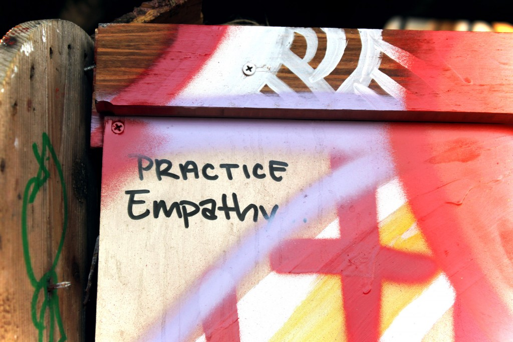 Picture of some graffite with the word empathy in the middle