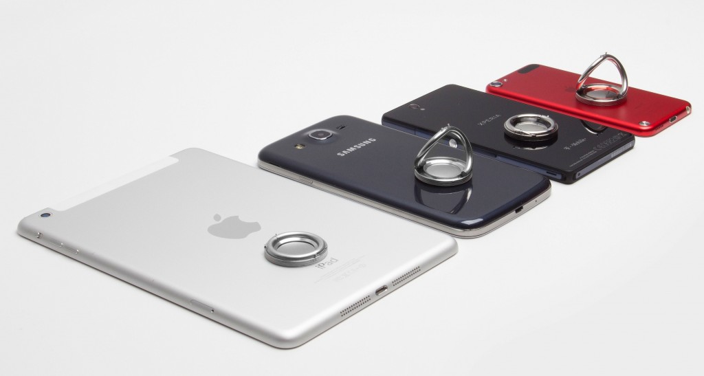 Picture of 4 i-Ox's Together. They are a metal ring that attaches to your phone to make it easy to hold.