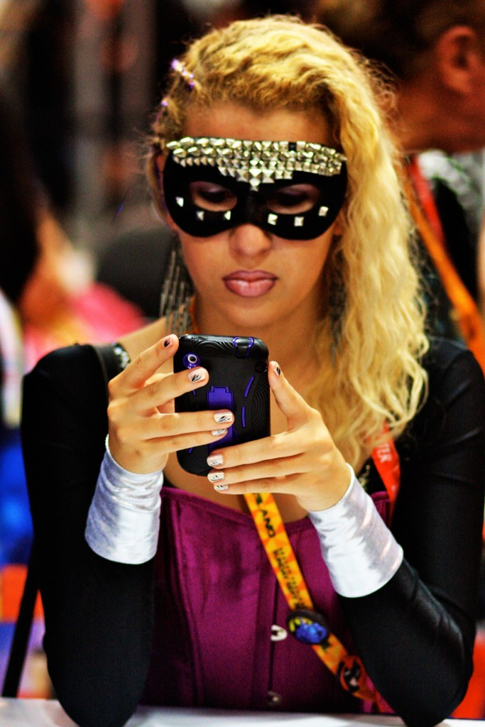 Picture of a Woman In A Mask Using A Phone