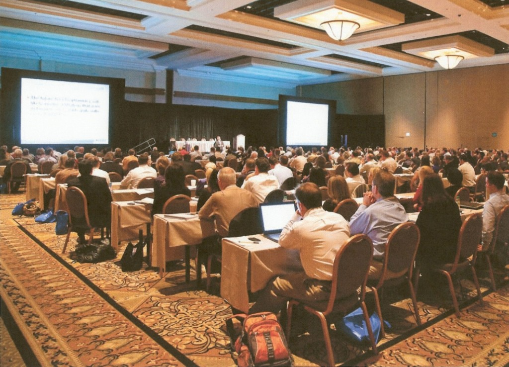 Picture of a full room at a seminar