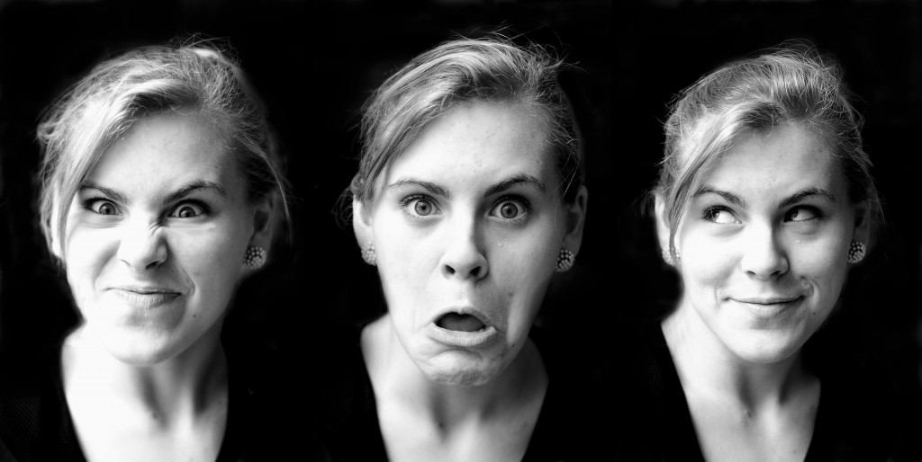 Picture of a woman with three different expressions on black background