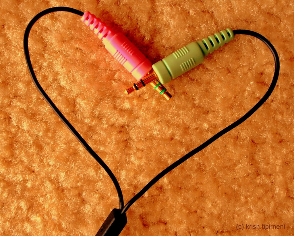 Picture of two headphone wires in heart share, connecting at the top