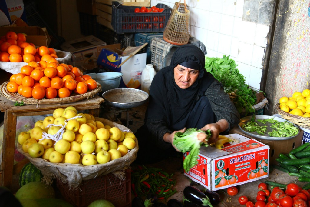 Picture of a woman in a market building a relationship with customers