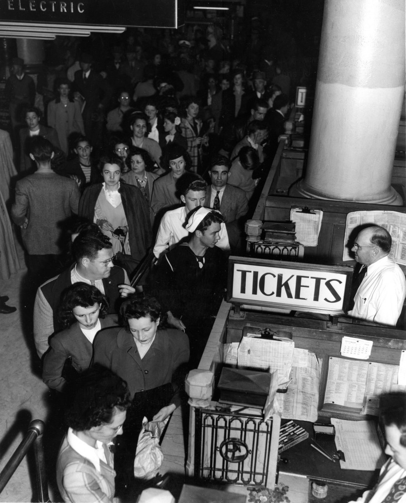 Picture of people queuing up for tickets at a cinema