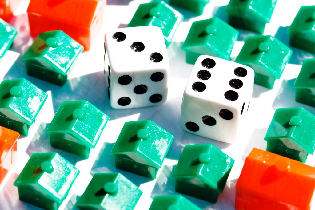 Picture of monopoly houses with dice in the middle of them