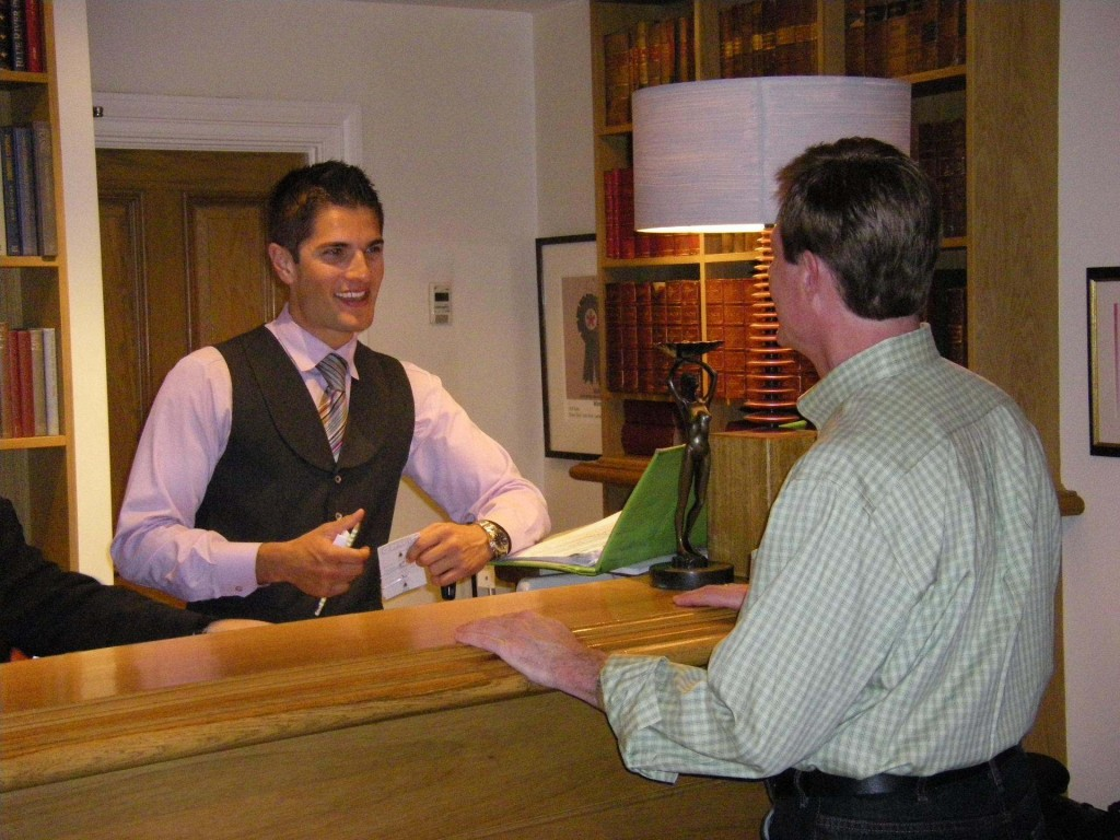 Picture of a hotel reception where great customer service is just about to be given.