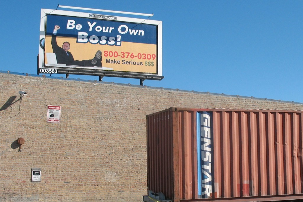 Picture of a billboard that says Be Your Own Boss on