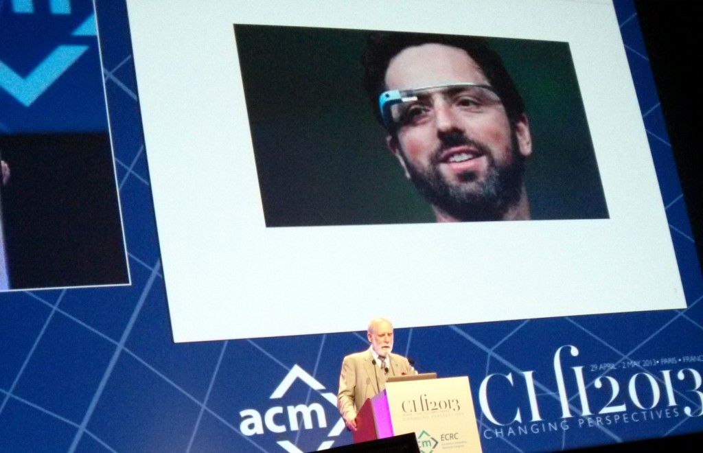 A Picture of a presentation with a slide with google glass on