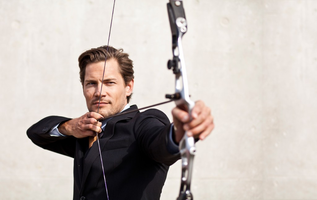 Picture of a man with a bow and arrow shooting for the SMART-ER Rules for Better Business