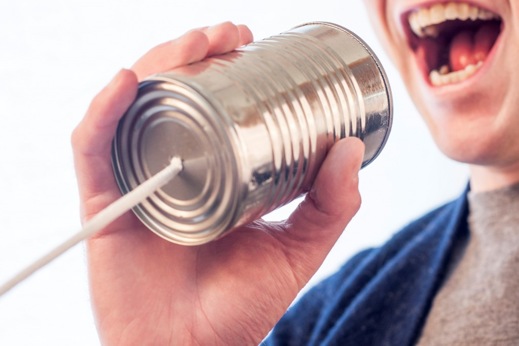 Picture of a tin can with string in to show how to grow a PR agency