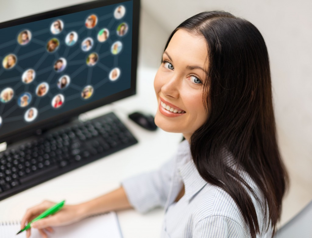 Picture of a woman at a computer with lots of links coming into her linkable content on screen
