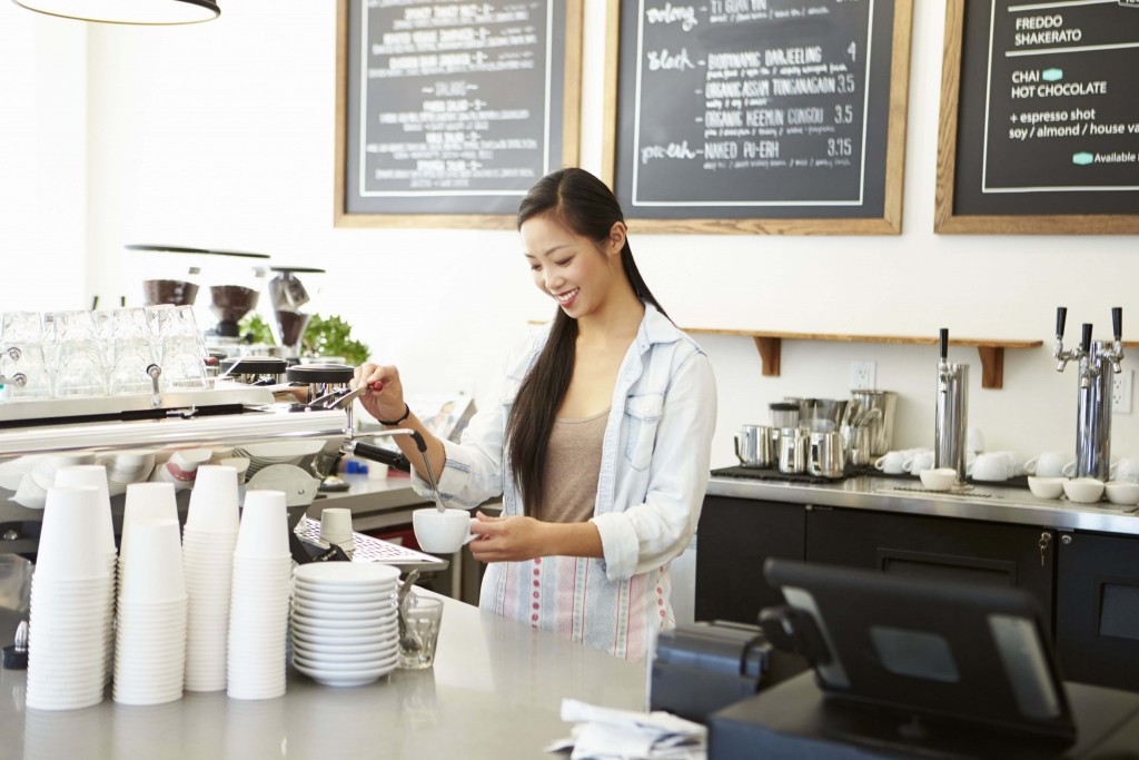 Picture of a woman in a successful cafe who has done really well with Niche SEO to get traffic in the door