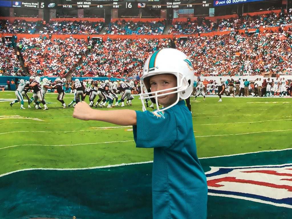Picture of a young millennial at a NFL game